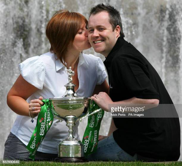 The 888com World Snooker Champion John Higgins gets a kiss from his wife Denise during a photo call at the Mercure St Paul's Hotel Sheffield