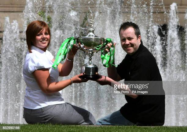 The 888com World Snooker Champion John Higgins with wife Denise during a photo call at the Mercure St Paul's Hotel Sheffield