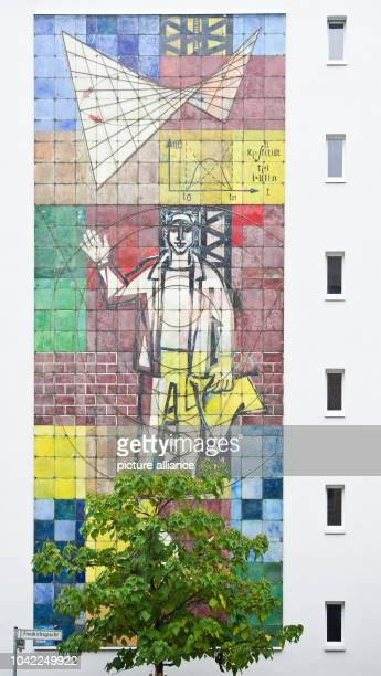 The 90 square meter large mural 'man the measure' by Walter Womacka on the side of a plattenbau in BerlinGermany 10October 2013 The artwork made...