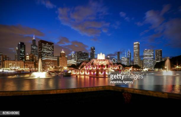 The 90year old Buckingham Fountain is seen in front of the Loop skylines at Grant Park during night time in Chicago United States on August 09 2017...