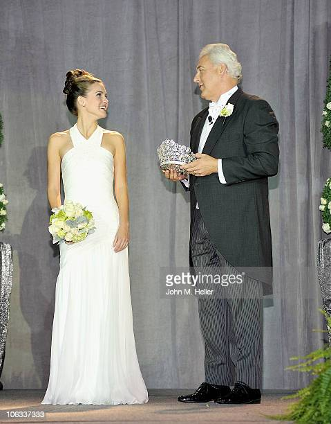 The 93rd Rose Queen Evanne Elizabeth Friedmann receives the crown from President of the 2011 Tournament of Roses Jeffrey LThroop at the Pasadena...