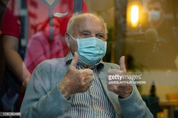 The 96-year-old Jos Hermans, the first Belgian who will receive Pfizer-BioNTech coronavirus vaccine, gives a thumbs up during a press conference...
