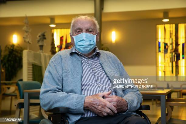 The 96-year-old Jos Hermans, the first Belgian who will receive Pfizer-BioNTech coronavirus vaccine, sits in a wheelchair during a press conference...