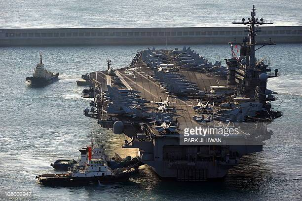 The 97000ton aircraft carrier USS CVN70 Carl Vinson arrives at the southern port city of Busan on January 11 2011 Meanwhile North Korea has...