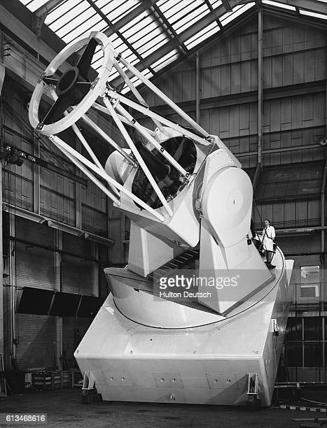 The 98 inch Isaac Newton Telescope the largest in Europe at the time under construction at the works of Grubb Parsons in NewcastleuponTyne When...