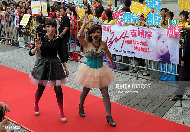The 988 DJs arrives at the 13th Global Chinese Music Awards at Putra Stadium on October 5 2013 in Kuala Lumpur Malaysia