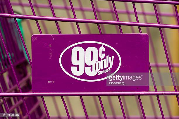 The 99 Cents Only Store logo is displayed on a shopping cart at a store in Oakland California US on Monday Aug 22 2011 Apollo Global Management LLC...