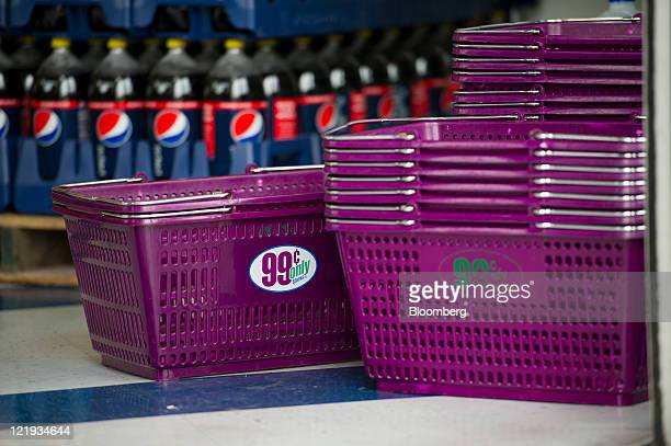 The 99 Cents Only Store logo is displayed on shopping baskets at a store in Oakland California US on Monday Aug 22 2011 Apollo Global Management LLC...