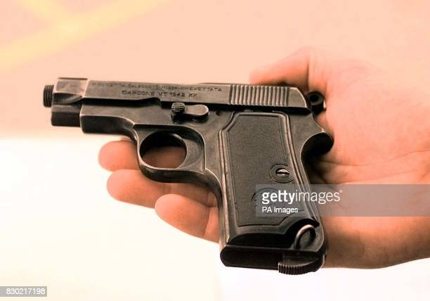 The 9mm Beretta pistol used by postal worker James E Robinson in the killing of Postal investigator Andrew Thomas Gardner Robinson pleaded guilty...