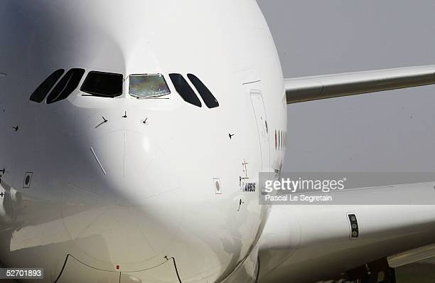 The A380 the world's largest commercial airliner is seen as it makes its maiden flight on April 27 2005 in Toulouse southern France The fourengine...