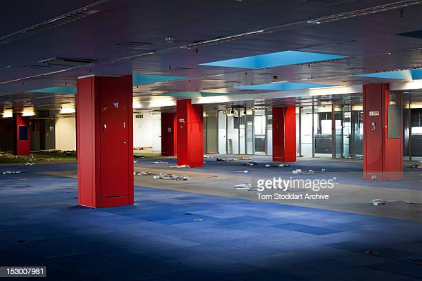 The abandoned interior of the Sun newsroom inside the former News International base in Wapping, East London. Media mogul Rupert Murdoch moved his...