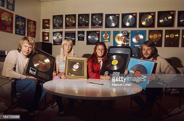 The ABBA posing in a room filled with their numerous gold records and platinum with from left to right Bjorn Ulvaeus and his wife Agnetha Faltskog...