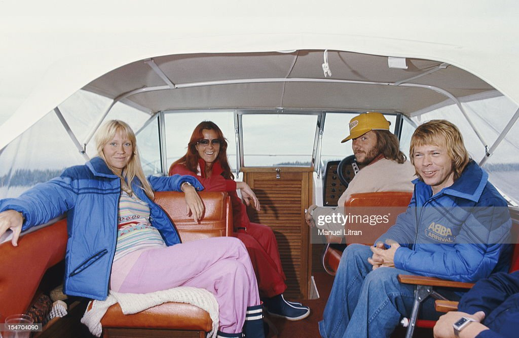 The ABBA posing on a boat with Bjorn Ulvaeus and Agnetha Faltskog his wife (in blue), Anni-Frid Lyngstad (Frida called) and her husband Benny Andersson at the helm.