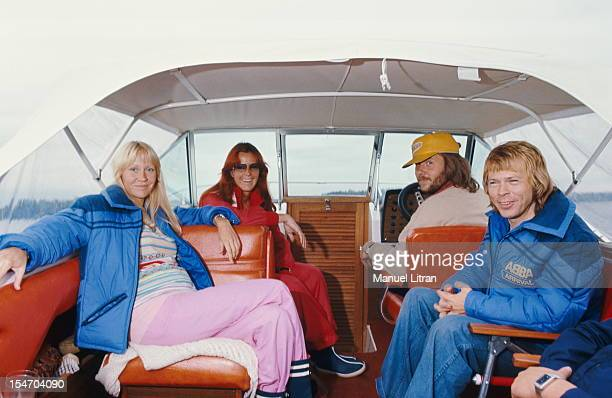 The ABBA posing on a boat with Bjorn Ulvaeus and Agnetha Faltskog his wife AnniFrid Lyngstad and her husband Benny Andersson at the helm