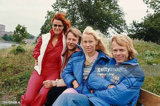 The ABBA sitting on a bench in the open air with AnniFrid Lyngstad and her husband Benny Andersson Agnetha Faltskog and Bjorn Ulvaeus her husband
