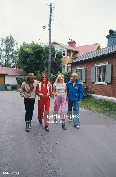 The ABBA walking in a street of a village with AnniFrid Lyngstad and her husband Benny Andersson Agnetha Faltskog and Bjorn Ulvaeus her husband