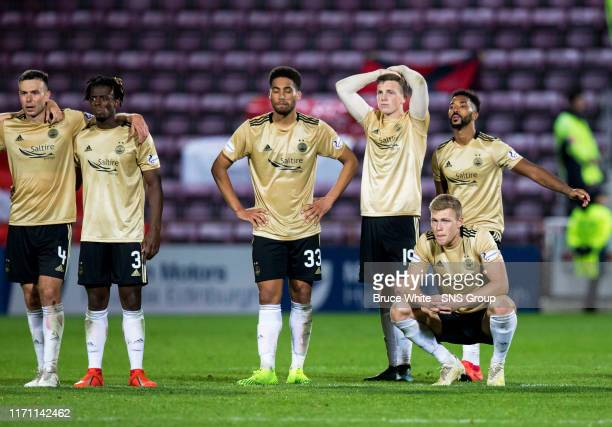 The Aberdeen players look frustrated after losing the penalty shootout during the Betfred Cup Quarter-Final match between Heart of Midlothian and...