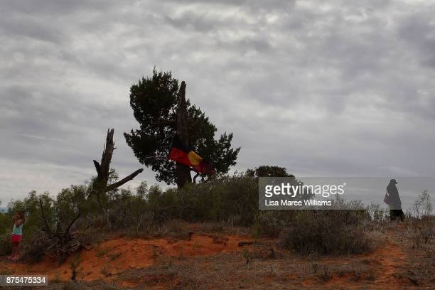 The Aboriginal flag hangs from a tree at the ceremony site in the Lake Mungo region for the return of Mungo Mans 40000 year old remains to country on...