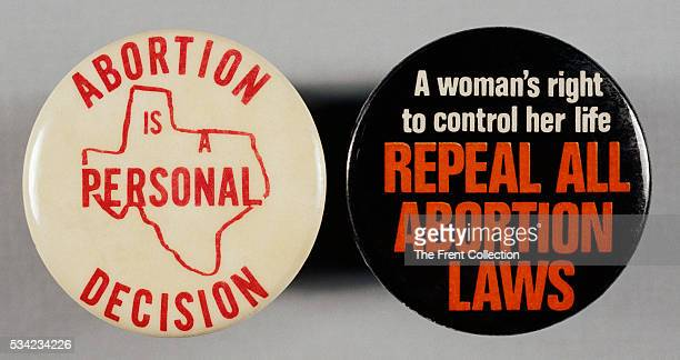 The abortion issue prompted demonstration in Washington DC where members of each side had buttons made to express their opinion