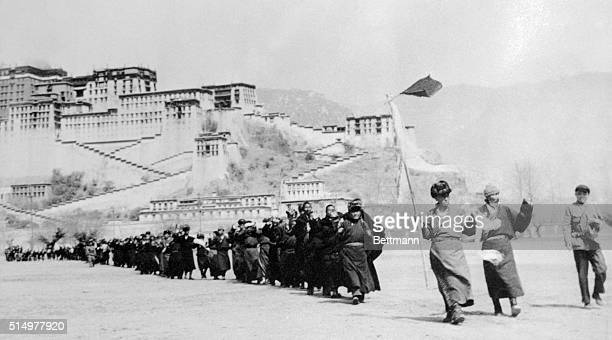 The above photo showing Tibetan rebels filing out of the Potala Palace here to surrender was released from a Chinese Communist source with the...