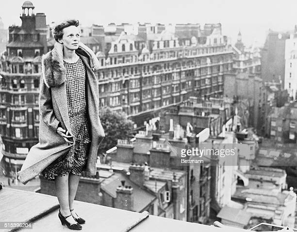 The above photo shows Miss Amelia Earhart copilot of the transatlantic plane Friendship atop the roof of the Hyde Park Hotel in London getting a view