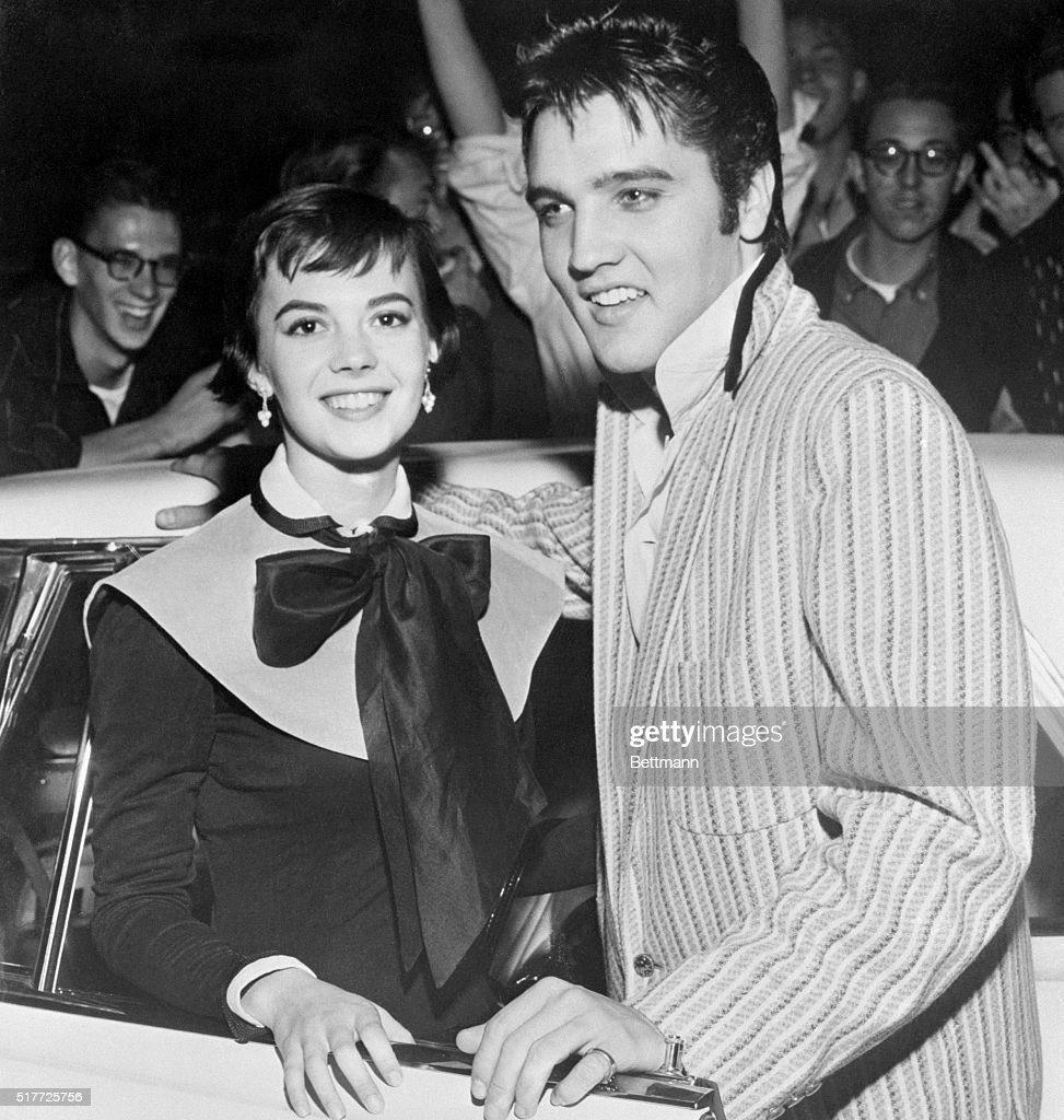 The above photograph, which is almost certain to 'fracture' the hearts of countless teenage American girls, shows rock and roll singer Elvis Presley together with Hollywood actress Natalie Wood in the singer's home town. Presley returned from New York and Miss Wood flew in from the West Coast for the get-together.