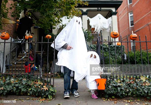 """The Abrahms family of Fort Greene, Brooklyn """"trick or treat"""" as Brooklyn residents participate in Halloween activities on October 31, 2012 in New..."""