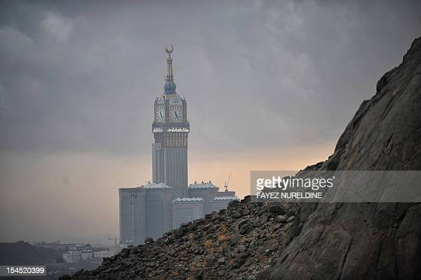 The Abraj AlBait Towers also known as the Mecca Royal Hotel Clock Tower is seen from Jabal alNoor or 'Mountain of Light' overlooking the holy city of...