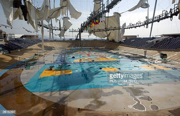 The Abuja velodrome is in shreds 19 October 2003 after it was wrecked by a rain storm before the closing ceremony of the All Africa Games 18 October...