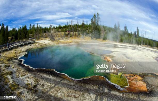 The Abyss geothermal pool is seen October 8 2012 in Yellowstone National Park in Wyoming Yellowstone protects 10000 or so geysers mudpots steamvents...