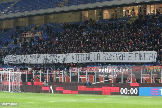 The AC Milan fans display a giant banner against Gianluigi Donnarumma before the Tim Cup match between AC Milan and Hellas Verona FC at Stadio...