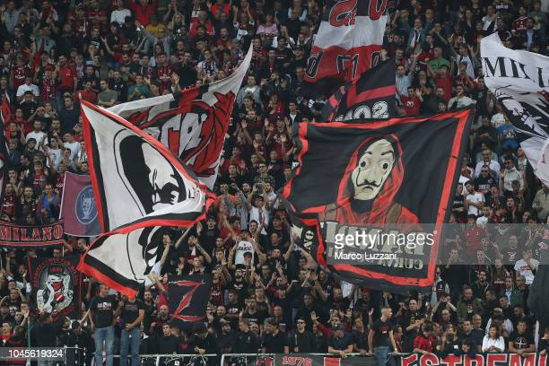 The AC Milan fans show their support during the UEFA Europa League Group F match between AC Milan and Olympiacos at Stadio Giuseppe Meazza on October...