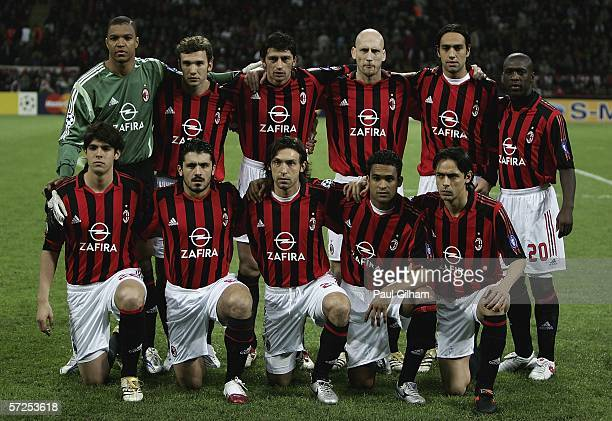 The AC Milan team line up together before the start of the UEFA Champions League Quarter Final Second Leg match between AC Milan and Lyon at the San...