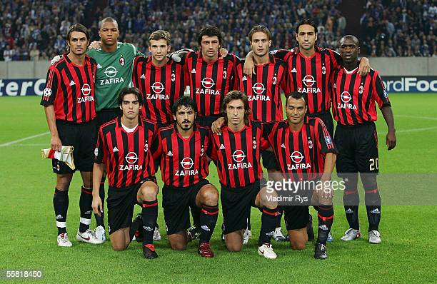 The AC Milan team pose for photographers ahead the UEFA Champions League Group E match between FC Schalke 04 and AC Milan at the Veltins Arena on...