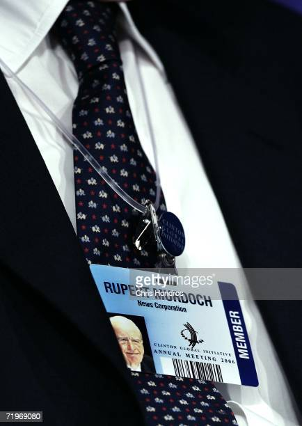The access pass of Rupert Murdoch Chairman and Chief Executive Officer News Corporation is seen hanging around his neck during a panel discussion at...