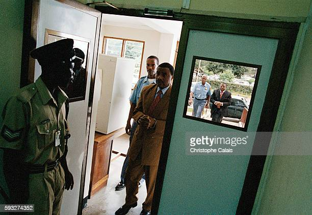 The accused arrive at the court under a tight security escort led by Major Aloys Ntabakuzu former leader of the parachute commandos in Kigali Behind...