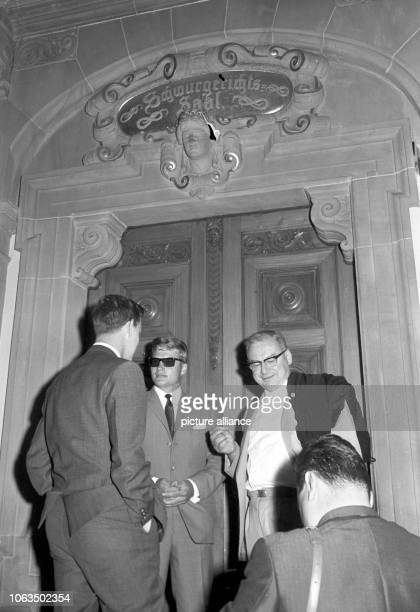 The accused HansDieter Raub and his defender are standing in front of the jury court room of the district court in Tubingen before the beginning of...