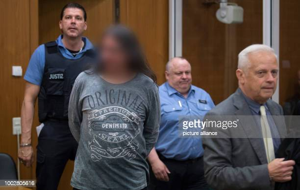 The accused Hell's Angel being escorted into the security hall of the District Court before the start of proceedings in Frankfurt am Main Germany 19...