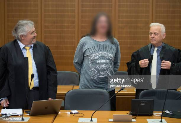 The accused Hell's Angel stands between his two attorneys Manuel Mayer and Michael Oberwinder during the start of proceedings in the security hall of...