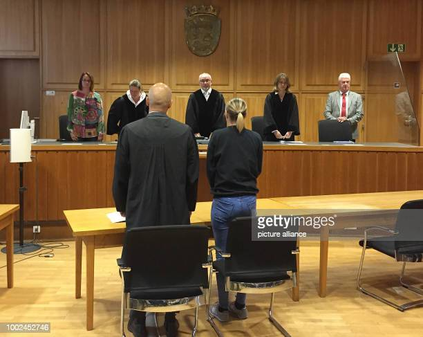 The accused in a murder trial pictured next to her lawyer during the handing down of the verdict in a hall in the Heilbronn District Court in...