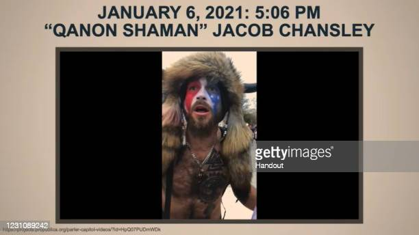 "The accused U.S. Capitol rioter dubbed the ""QAnon Shaman,"" Jacob Chansley is shown in an exhibit during the presentation by House Impeachment manager..."