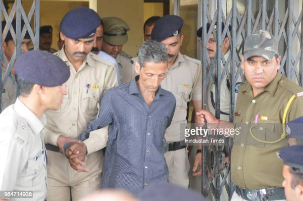 The accused Vijay Singh who murdered a woman is being taken to Kasauli Court on May 4 2018 in Kasouli India The police arrested Vijay Singh accused...