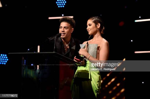 The Ace Family's Austin McBroom and Catherine Paiz recipients of the Board of Governors award speak onstage at Thirst Project 10th Annual Thirst Gala...