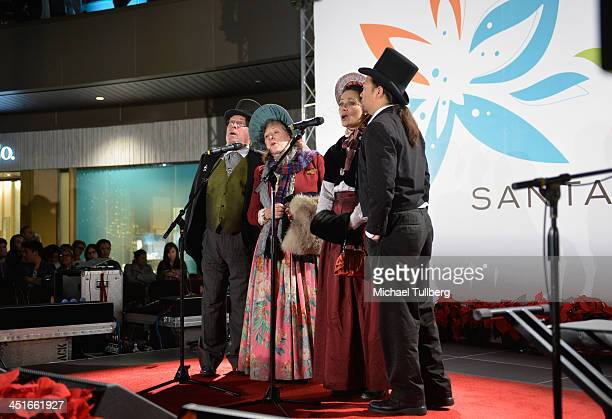 The Ace Of Hearts Holiday Carolers perform at the unveiling of the HGTV Holiday House at Santa Monica Place on November 23 2013 in Santa Monica...