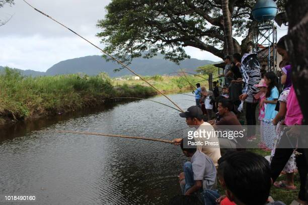 The Acehnese take part in a fishing competition This fishing competition is one of a series of Nusa Festival events to commemorate Indonesia's...