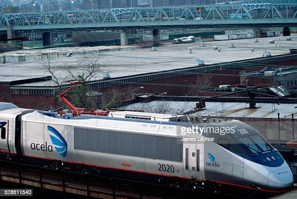 The Acela express train leaves New York City with a view of the Bronx