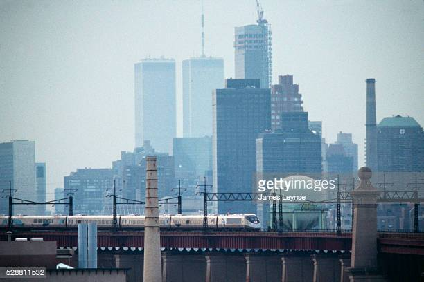 The Acela express train leaves New York City with a view of the World Trade Center's Twin Towers behind it