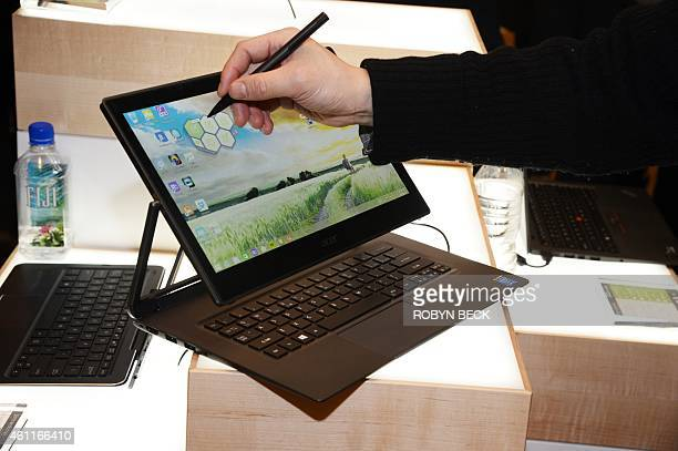 The Acer Aspire R13 laptop and tablet is displayed at the Consumer Electronics Show in Las Vegas Nevada on January 7 2015 The Aspire R13's contorts...