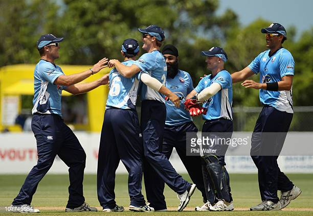 The Aces celebrate the dismissal of Fawad Alam of Pakistan during the Twenty20 trial match between Pakistan and the Auckland Aces at Colin Maiden...