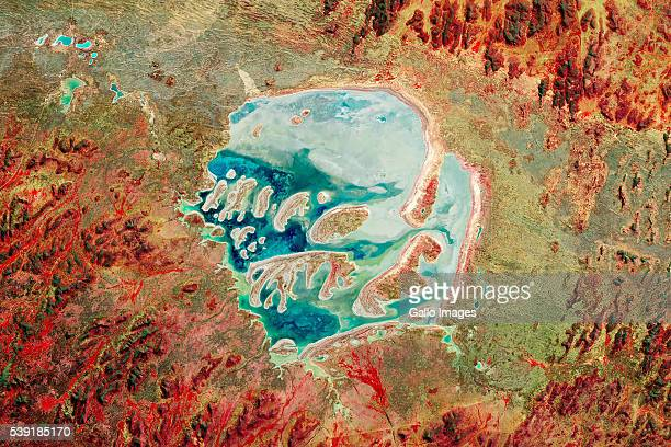 The Acraman crater in South Australia created by an asteroid impact 590 million years ago This false colour satellite image shows Lake Acraman in the...
